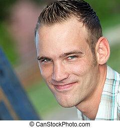 Smiling modern young man