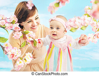 Smiling mom holding her daughter