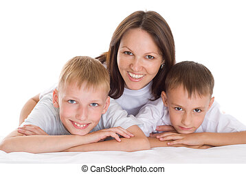 smiling mom sitting at the desk with sons
