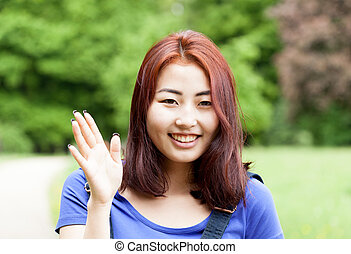 Smiling mongolian girl in a park