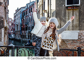 smiling mother and child in Venice, Italy travellers rejoicing