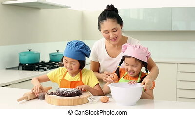 Smiling mother and cute daughters b