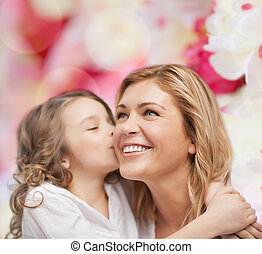 smiling mother and daughter hugging - family, child and...