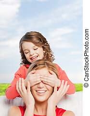 smiling mother and daughter making a joke