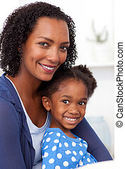 Smiling mother and her little girl - Smiling Afro-american...