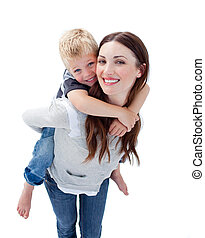 Smiling mother giving her son piggyback ride
