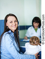 Smiling mother with her child at doctors office