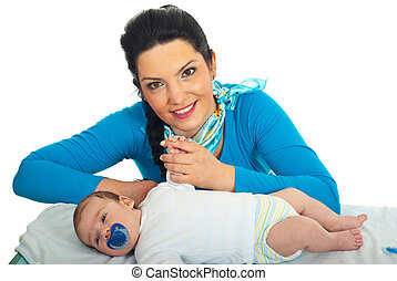 Smiling mother with newborn baby
