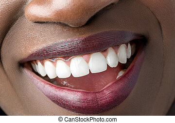 Smiling mouth of african girl.