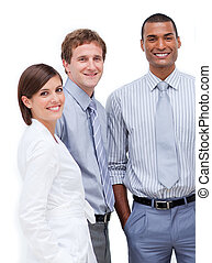 Smiling multi-ethnic business people standing together in...