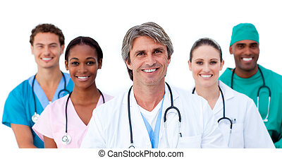 Smiling multi-ethnic medical team against a white background