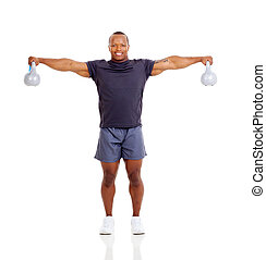 muscular african man with kettle bells