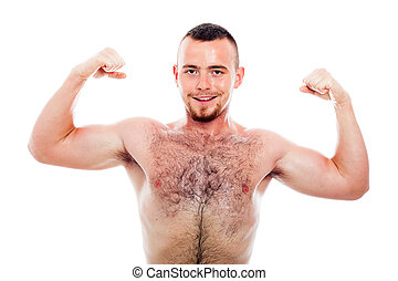 Smiling muscular sports man showing biceps