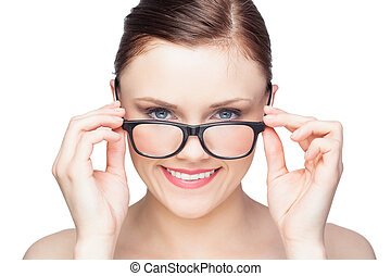 Smiling natural model looking over her classy glasses