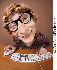 Smiling nerd - at a computer