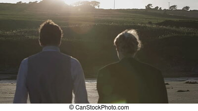 Smiling newlyweds walking together