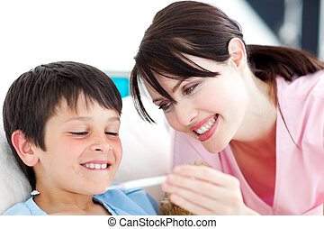 Smiling nurse and his patient looking at a thermometer