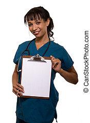 Smiling nurse - Attractive smiling nurse wearing scrubs...