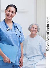 Smiling nurse holding a folder