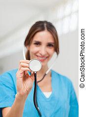 Smiling nurse holding a stethoscope
