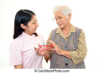 Smiling nurse with elderly woman
