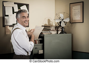 Smiling office worker searching for a file.