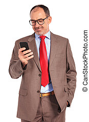 smiling old businessman reading a message or texting