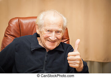 smiling old man showing thumbs up