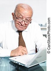 smiling old man with laptop