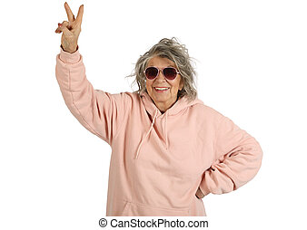 Smiling old woman shows a victory sign