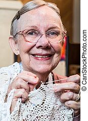 Smiling Old Woman with Crochet