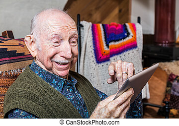 Smiling Older Gentleman with Tablet
