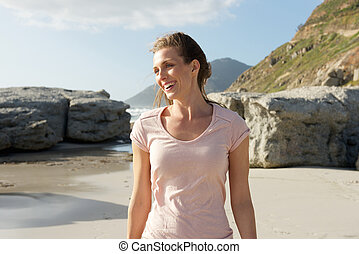 Smiling older woman at the beach