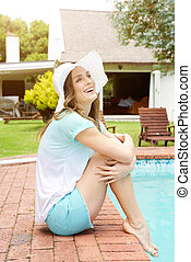 Smiling older woman relaxing by pool