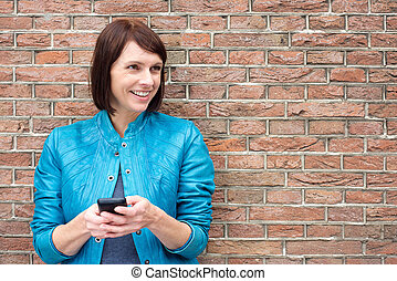 Smiling older woman with mobile phone