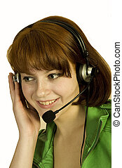 Smiling operator young woman in a call center