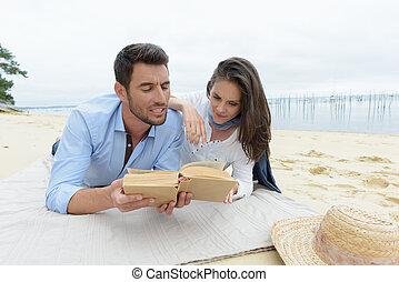 smiling pair on sand beach