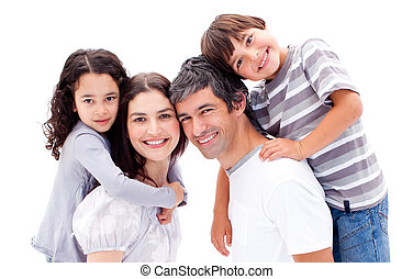 Smiling parents giving their children a piggyback ride