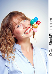 Smiling party person with birthday balloons