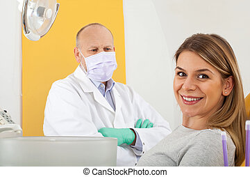 Smiling patient at the dentist office