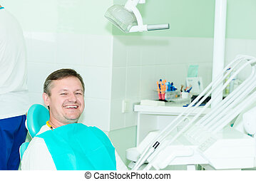 smiling patient looking at camera at the dentist office
