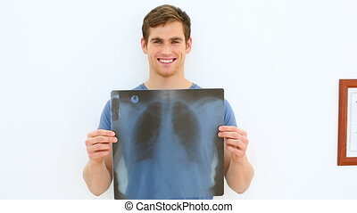 Smiling patient showing his positive x-ray