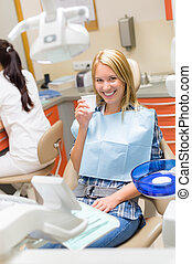 Smiling patient sit dental chair modern surgery