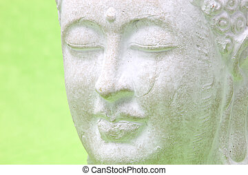 Head of smiling peaceful yoga white statue, close up