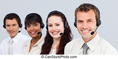 Smiling people with a headset on working in a call center