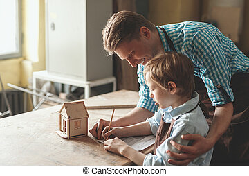 Smiling people with a wooden house