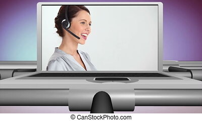 Smiling people working in a call ce