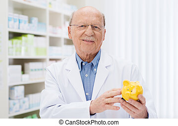 Smiling pharmacist holding a piggy bank as he urges people to invest and save against the rising cost of medicine
