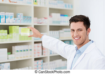 Smiling pharmacist promoting a product