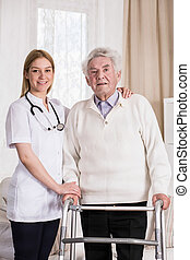 Smiling physician and senior man